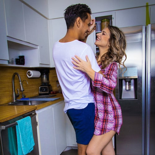Hervin and Oana dancing in the kitchen